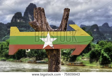 Myanmar wooden sign with a forest on background