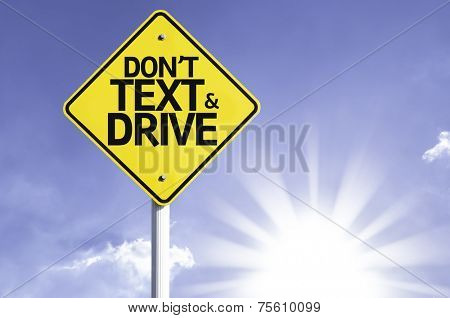 Don't text and Drive road sign with sun background