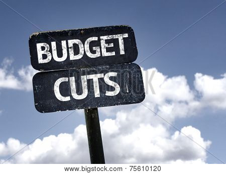 Budget Cuts sign with clouds and sky background
