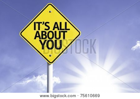 It's All About You road sign with sun background