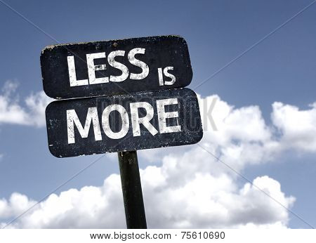 Less is More sign with clouds and sky background