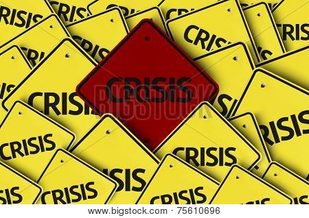 Crisis written on multiple road sign
