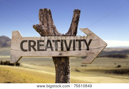 Creativity wooden sign with a desert background
