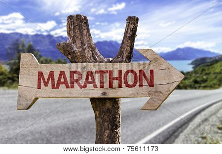 Marathon wooden sign with a street background