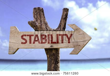 Stability wooden sign with a beach on background