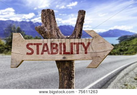 Stability wooden sign with a street background