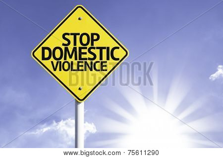 Stop Domestic Violence road sign with sun background