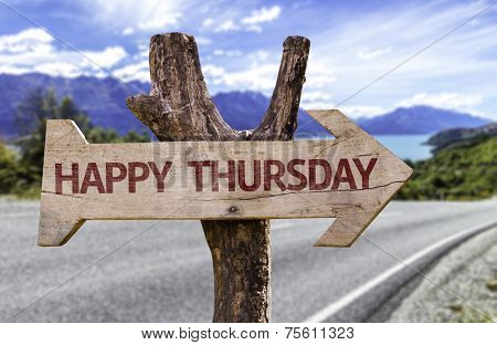 Happy Thursday wooden sign with a street background