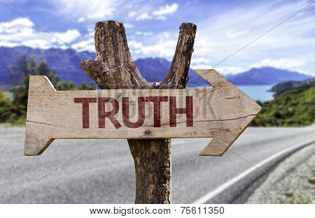 Truth wooden sign with a street background