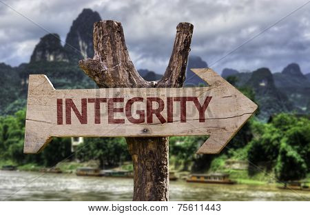 Integrity wooden sign with a forest background