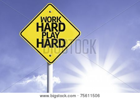 Work Hard Play Hard road sign with sun background
