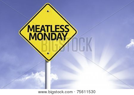 Meatless Monday road sign with sun background