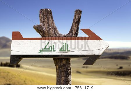 Iraq wooden sign with a desert background