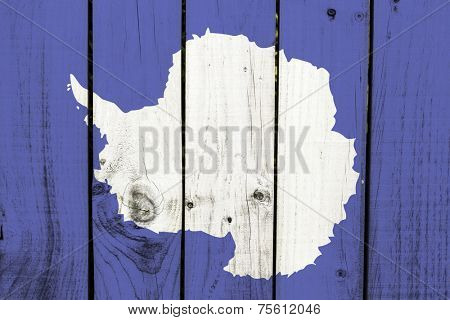 Antarctica flag on wooden background