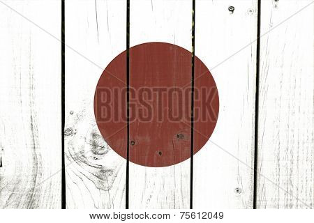 Japan flag on wooden background