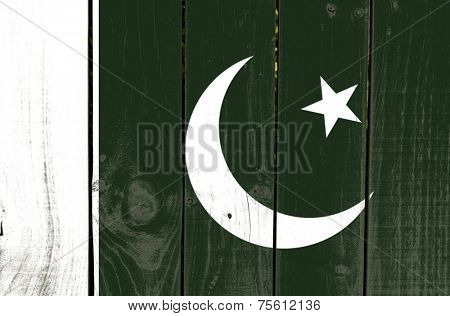 Pakistan flag on wooden background