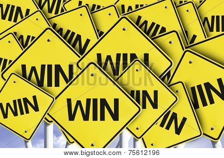 Win written on multiple road sign