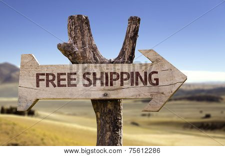 Free Shipping wooden sign with a street background