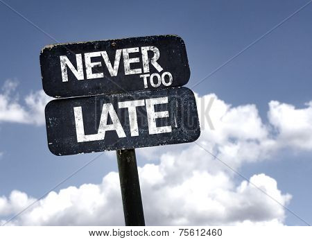 Never too Late sign with clouds and sky background
