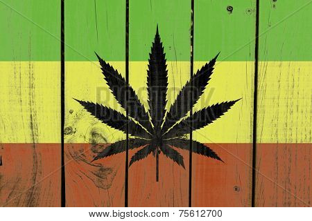Rasta Flag With Marijuana Leaf on wooden background