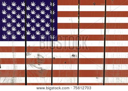 United States with Leaf of Marijuana Flag on wooden background