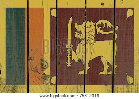 Sri Lanka flag on wooden background