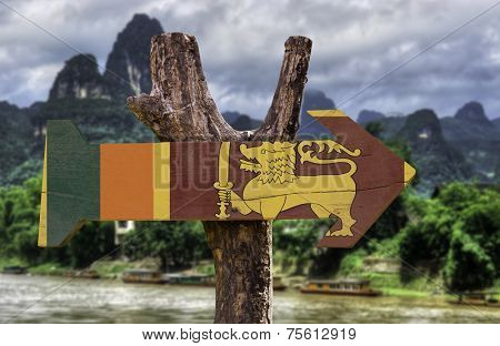 Sri Lanka wooden sign with rural background
