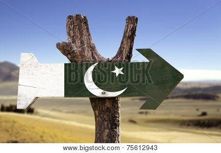 Pakistan wooden sign with a desert background