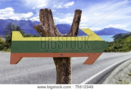 Lithuania wooden sign with a landscape background