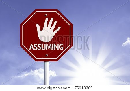 Stop Assuming red sign with sun background