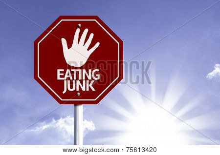 Stop Eating Junk red sign with sun background