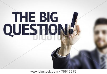 Business man pointing to transparent board with text: The Big Question!