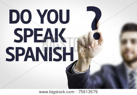 Business man pointing to transparent board with text: Do you Speak Spanish?