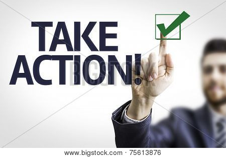 Business man pointing to transparent board with text: Take Action!