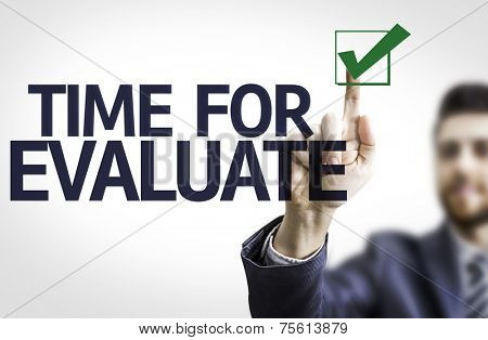 Business man pointing to transparent board with text: Time For Evaluate