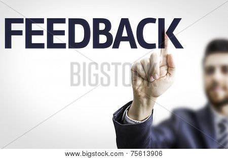 Business man pointing to transparent board with text: Feedback