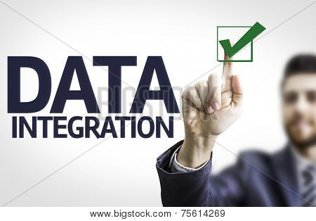 Business man pointing to transparent board with text: Data Integration