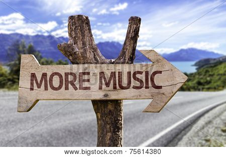 More Music wooden sign with a landscape background