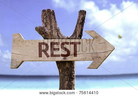 Rest wooden sign with a beach on background