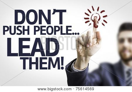 Business man pointing to transparent board with text: Don't Push People...Lead Them!