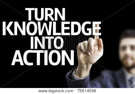 Business man pointing to black board with text: Turn Knowledge Into Action