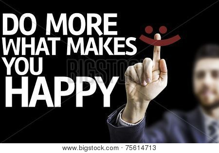 Business man pointing to black board with text: Do More Of What Makes You Happy