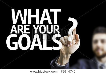 Business man pointing to black board with text: What are Your Goals?