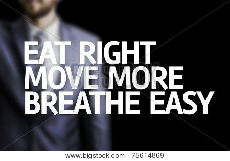 Eat Right, Move More, Breathe Easy written on a board with a business man on background