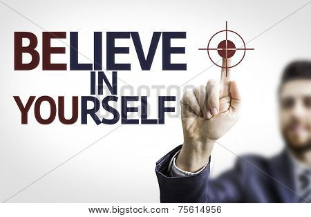 Business man pointing to transparent board with text: Believe in Yourself