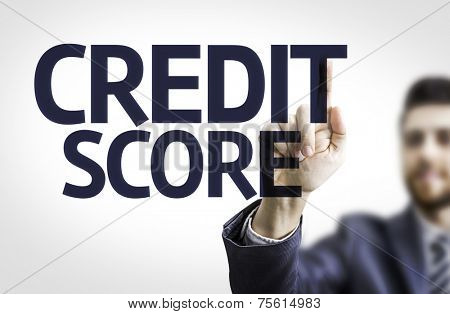 Business man pointing to transparent board with text: Credit Score