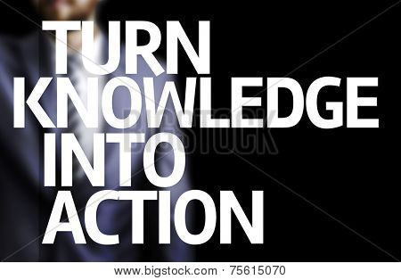 Turn Knowledge Into Action written on a board with a business man on background