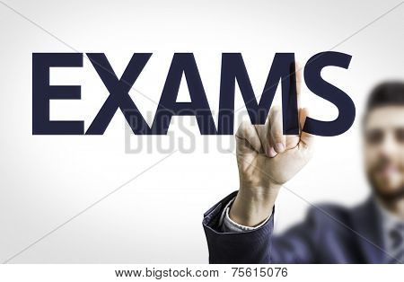 Business man pointing to transparent board with text: Exams
