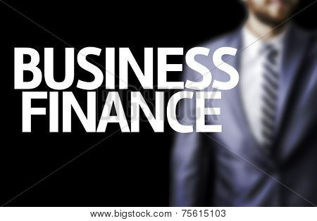 Business Finance written on a board with a business man on background