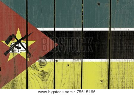 Mozambique flag on wooden background